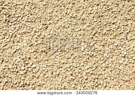 Grainy Texture Of Decorative Plaster. Tiny Grains Little Stones In Cement Or Concrete. Vintage Decor