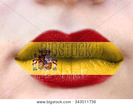 Female Lips Close Up With A Picture Flag Of Spain. Learning Languages.