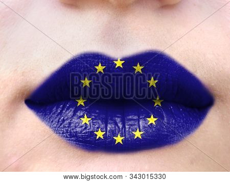 Female Lips Close Up With A Picture Flag Of European Union. Learning Languages.