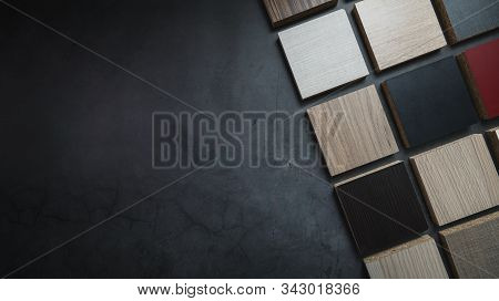 Wood Texture Particle Board Laminate Material Samples On Dark Stone Background With Copy Space