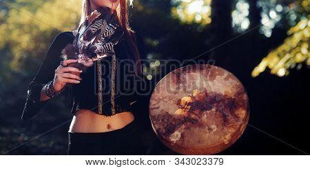 Shaman Woman And Shamanic Feathers On Denim.