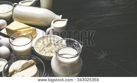Dairy Products On Black Wooden Background With Copy Space