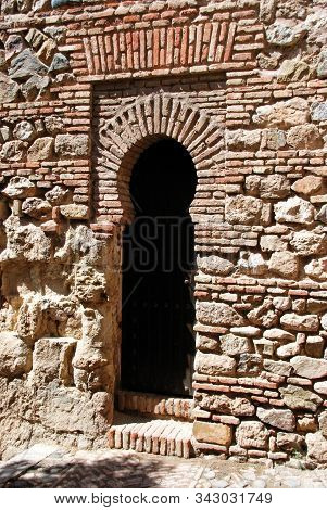 Malaga, Spain - July 7, 2008 - Narrow Arched Doorway Off The Suppliers Courtyard At Malaga Castle, M