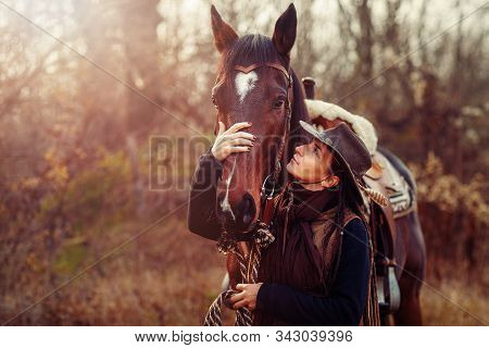 Portrait Woman And Horse Outdoors. Woman Hugging A Horse.