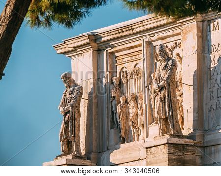 Rome, Italy. Details Of Arch Of Constantine. Statue And Bas-relief On Facade Of Triumphal Arch.