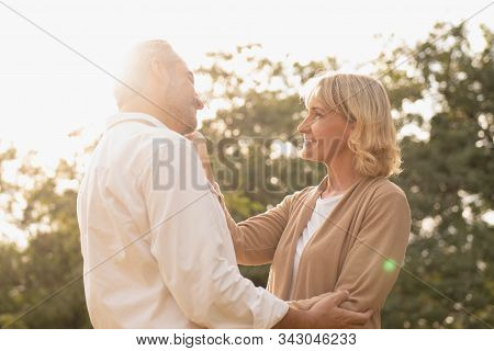 Portrait Of Senior Caucasian Couple Holding Each Other Feeling Loved And Happy In The Afternoon Sun,