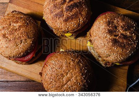 Chicken Burger With Cheese On A Wooden Background