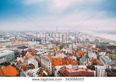 Riga, Latvia - December 19, 2017: Top View Cityscape In Misty Fog Rainy Day. Latvian Academy Of Scie