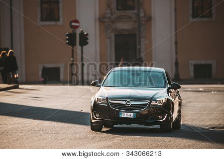 Rome, Italy - October 19, 2018: Black Color Opel Insignia With Face-lift In First Generation Moving