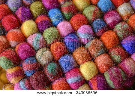 Knitting Yarn On A Beautiful And Colorful Background.