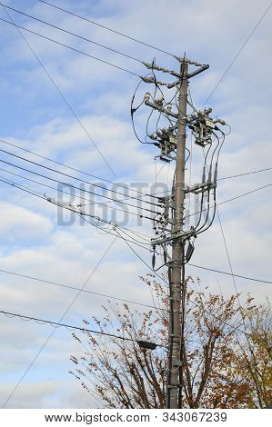 High Voltage Electricity Pole In The Sky Background