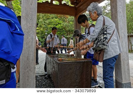 Kamakura, Japan, May 13, 2019 : Traditional Ablution At The Entrance Of Kotoku-in. The Temple Is Ren