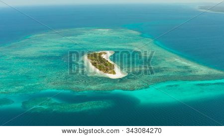 Tropical Island On An Atoll With Beautiful Sandy Beach By Coral Reef From Above. Canimeran Island An