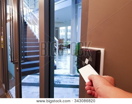 Men Hand Reaching To Use Rfid Key Card To Access The Area. In Building Security Only For Authorized