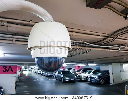 Security Surveillance Camera Inside Car Park Building Walk Way. Record Situation Around Area Standar
