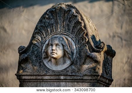 Tombstone With The Face Of A Young Girl At Dorotheenstädtischer Friedhof In Berlin
