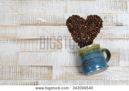 Coffee Bean Heart Coming Out Of A Colorful Coffee Mug On Rustic White Wood Background With Copy Spac