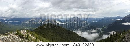 View Of Banff National Park In The Canadian Rockies From The Top Of A Mountain After Taking The Banf