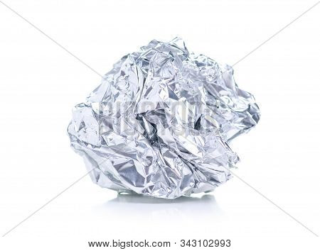 Crumpled Ball Of Aluminum Foil On White Background Isolation