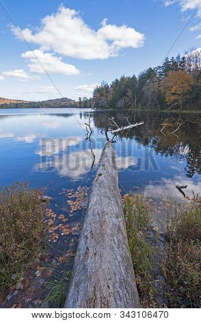 Calm Waters And Serene Skies On Moss Lake In The Adirondacks In New York