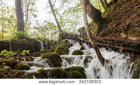 Plitvicka Lakes National Park - Beautiful Nature With Water Falling Down The Slope Over The Mossy Ro