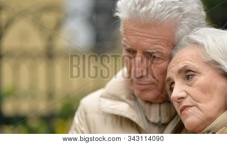 Close Up Portrait Of Sad Thoughtful Senior Couple