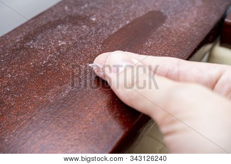 A Finger Swiping Dust From Furniture, Dusty Home Concept.
