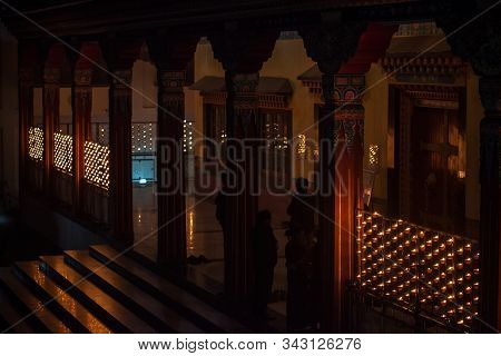 Solemn Evening Ritual Of Ignition Of Oil Candles In Temple Of The Tibetan Buddhism Lineage.