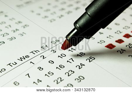 Cropped Shot Of Calendar Page And Black Pen, Top View. Abstact Business Concep.