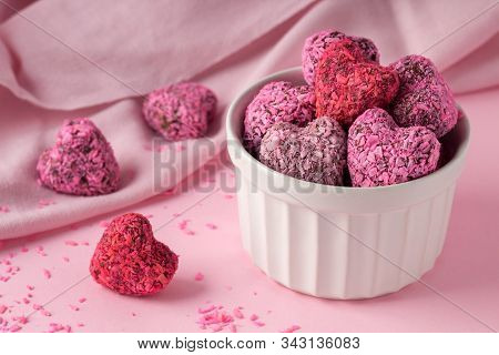 Heart Shaped Energy Bites For Valentine's Day On Pink Table