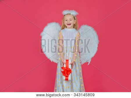 Valentines Day. Angel Child From Heaven Gives You Gift. Portrait Of Beautiful Angel Little Girl With