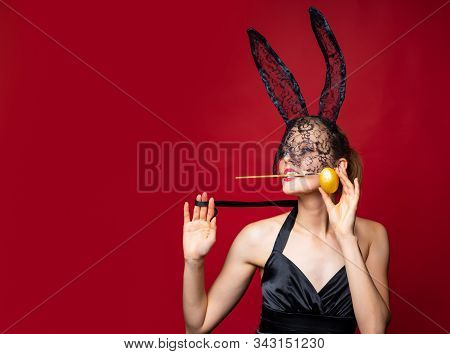 Sexy Woman Easter Bunny Wearing Mask And Ears Celebrating Easter Holidays. Young Sensual Provocative