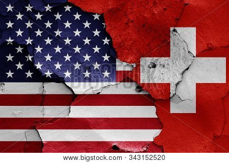 Flags Of Usa And Switzerland Painted On Cracked Wall