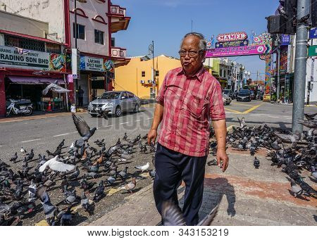 Malacca, Malaysia - Oct 4, 2014. People On Street In Malacca, Malaysia. Malacca (melaka) Was Listed