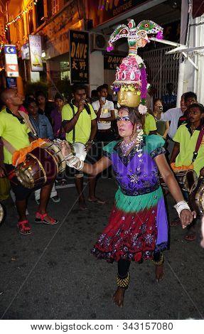 Malacca, Malaysia - Aug 18, 2014. Traditional Dancers On Night Street In Malacca, Malaysia. Malacca