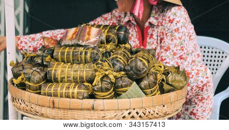 Street Food Stall Selling Traditional Holiday Banh Tet Wraps On The Street Of Can Tho, Mekong Delta,