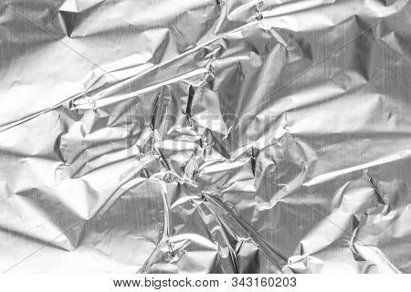 Close Up Of Aluminium Foil Crumpled. Silver Aluminium Foil Texture Background. Abstract Metallic Pap