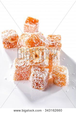 Turkish Delight Fruit-flavoured Rahat Lokum Pieces With Hazelnut  And  Coconut Crumbs Close-up Isola