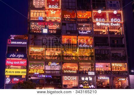 Illuminated Advertising Billboards And Signs At Ho Chi Minh District 1 At Night. Nguyen Hue Pedestri