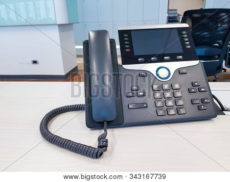 Ip Phone Device On Work Office Table Desk Background. Communication Technology To Connect And Call F