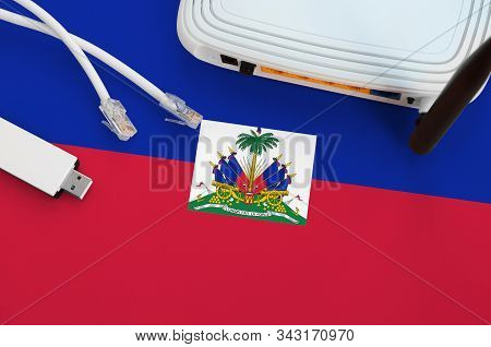 Haiti Flag Depicted On Table With Internet Rj45 Cable, Wireless Usb Wifi Adapter And Router. Interne