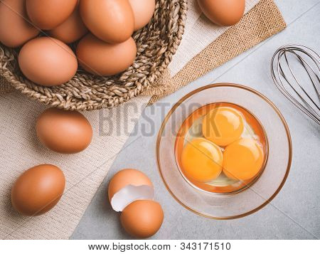 Top View And Close Up Image Of Three Eggs Yolk In Clear Bowl Are One Of The Food Ingredients On The