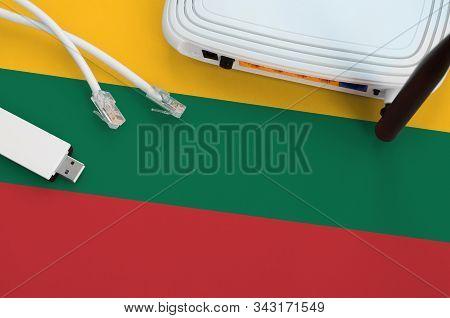 Lithuania Flag Depicted On Table With Internet Rj45 Cable, Wireless Usb Wifi Adapter And Router. Int