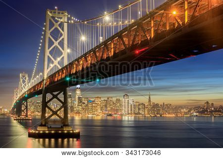 Western Span Of San Francisco-oakland Bay Bridge And San Francisco Waterfront In Blue Hour. Shot Fro