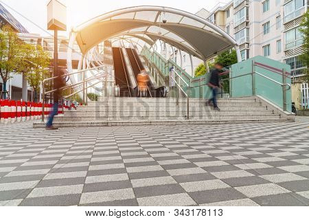Stairway For Exit And Entrance To Subway Station With People Moving Blur, Modern Architecture Of Sta