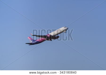 Krakow, Poland 20.12.2019: Wizz Air Airbus A321-231 Taking Off Against A Blue Sky, The Tail Number O
