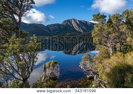 Mountains And Lake With Perfect Reflection Nature Background. Cradle Mountain And Lake Dove Landscap