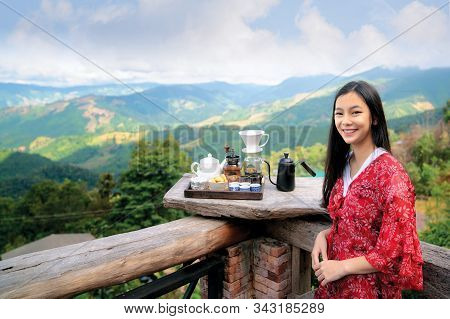 Asian Girl Relax With Hot Cofee And Hot Tea Set On View Point Of Doi Sakad, Pua, Nan, Thailand Near