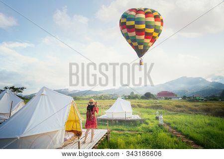 Asian Girl Take A Hot Air Balloon Photo By Camera In Countryside Homestay In Rice Farm In Pua, Nan P