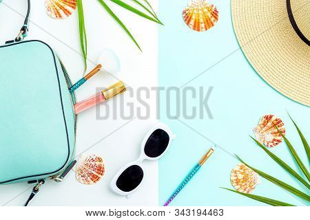 Travel Accessories. Feminine White  Sunglasses And Straw Hat On Blue And White Background. Copy Spac